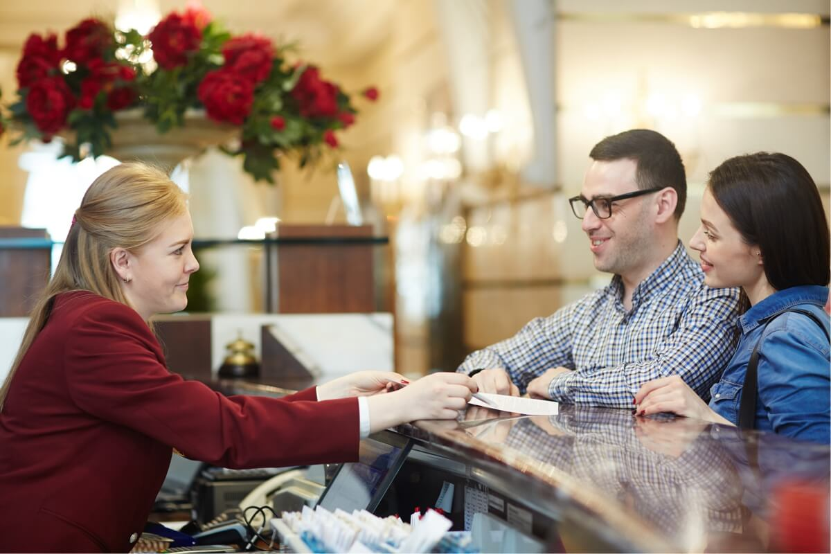receptionist serves customers
